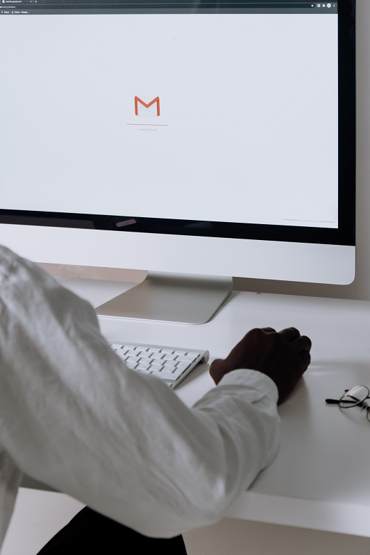 man using gmail on imac